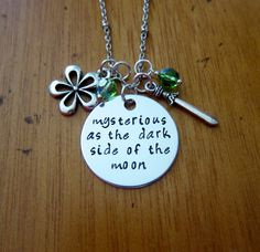 "Disney's ""Mulan"" Inspired Necklace. Song lyrics ""Mysterious as the dark side of the moon"". Silver colored, Swarovski crystals. Hand stamped. WithLoveFromOC on Etsy, $23.00"