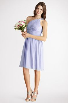 Subtle ruching highlights  this flowy one  shoulder iris chiffon dress  with a  flattering  set  in  waist.