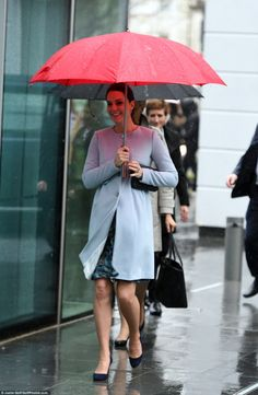 No raining on her parade! The Duchess looked cheerful despite the grim weather in London ...