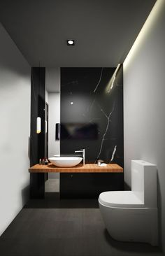 Another small bathroom that feature a black marble wall