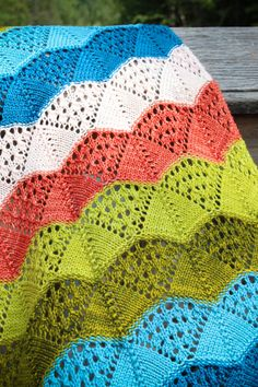 """Knitting Pattern for Lovequist Baby Blanket - Striped lace blanket is a colorful use for stash yarn The lace is ideal for babies because it offers ventilation and texture for them to play with. DK-weight yarn.26"""" Wide x 42"""" High. Designed byTanis Gray"""