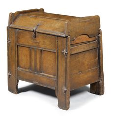 An English oak clamped-front ark  17th century the canted boarded detachable cover above a twin panelled front and later filled lockplate, with channelled stiles