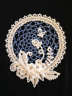 """Irish Crochet Sampler Doily. """"The pattern is from anniescatalog.com. BTW, the circle looks wonky because I hadn't blocked it yet when I took the photo!"""""""