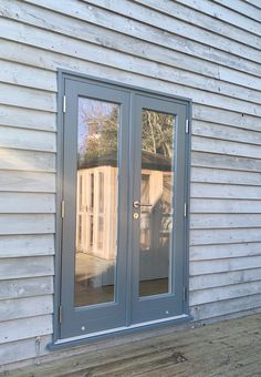 Timber French doors in blue grey finish. Suffolk Coast, Stainless Steel Doors, Smokehouse, Holiday Accommodation, Door Furniture, Best Hotels, Lovers Art, French Doors, Blue Grey