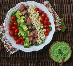steak salad with cilantro-jalapeno pesto. the pesto is also great on its own & the site gives ideas for how to use it. www.thewickednoodle.com