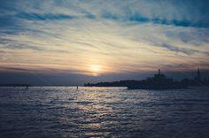 Sunset in Venice with a passing boat by Dreamy Pixel on Creative Market