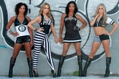 Where is the fashion police when you need them?  I can't tell if the second one is a prison outfit or a zebra.  They are doing way too much!  The Brooklynettes prepare for battle in the Thunderdome (via Brooklyn Nets).