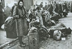 Civilians who have lost their homes to bombs during the Clydebank Blitz near Glasgow, Scotland - March 1941.