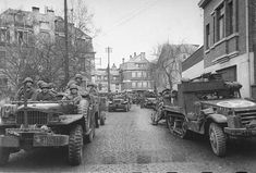 US troops and equipment lining the streets after sudden German breakthrough during the Battle of the Bulge