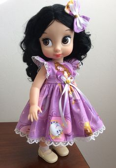 This is an adorable Tammys Boutique lilac Beauty & thr Beast dress set that was handmade to fit 16 Disney Animators Collection dolls. The set will include the adorable dress and matching bow.  The doll (Disney Animators Collection Snow White) is not for sale. If you buy two or more outfits I will combine shipping.  I will ship worldwide