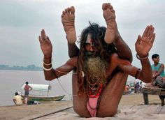 A Sadhu Or Holy Man Performs Yoga On The Banks Of River Ganges In Northern Indian City Allahabad June Sadhus Are Dedicated