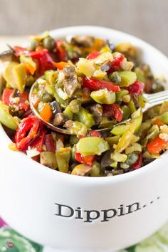 This salad is a mixture of garlic, assorted olives, and vinegar with some peppers thrown in there too. Use it to top a cracker, hang out with your boring chicken, or make an authentic New Orleans Muffuletta sandwich! New Orleans Olive Salad Recipe Muffaletta Olive Salad Recipe, Muffuletta Recipe, Muffuletta Sandwich, New Orleans Olive Salad Recipe, Olive Salad Recipe Italian, Italian Recipes, Appetizer Recipes, Salad Recipes, Appetizers