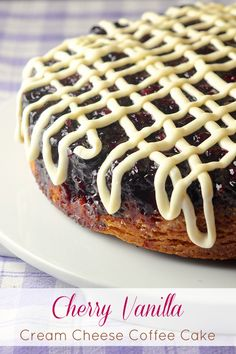 Cherry Vanilla Coffee Cake with Cream Cheese Glaze - a most vanilla scratch cake baked on top of sweet dark cherries then glazed with cream cheese frosting. Delicious at a celebration brunch but good enough to serve as a decadent dessert too, especially while still warm. Use frozen cherries in winter for a year round recipe.
