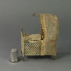 Antique 19th Century German Soft Metal Miniature Doll House Crib Canopy Cradle and Teeny Jointed 1.25' Bisque Doll Circa 1890