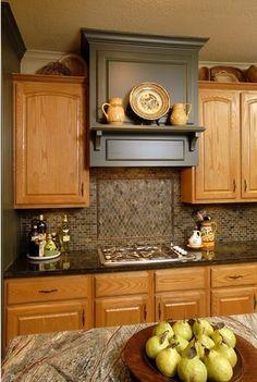 Kitchen with satin finish trim, designed by interior designer Carla Aston