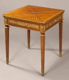 An Antique Card Table in the Louis XVI Manner
