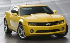 Yellow 2011 Camaro. Needs the black stripes. But this is an orgasmic  little thing.