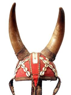 In traditional Africa, helmets were used not only as protection, but also to show status or rank. They can be carved from wood, cast in bronze or woven and embellished with horns, symbolic forms, cloth, cowries, metal strips and beads.