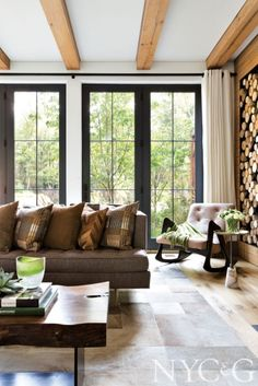 Patchwork hide area rug from Dualoy Leather featured in a rustic lakehouse living room; #NYC&G