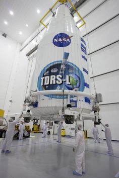NASA's Tracking and Data Relay Satellite, or TDRS-L, spacecraft has been encapsulated in its payload fairing. It is being lifted by crane fo...