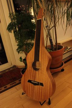 This is a Weissenborn (step ++++++++++++++) by Julien Lelievre Lutherie All solid mahogany // wenge fretboad and bridge // natural oil finish, no grain filler)