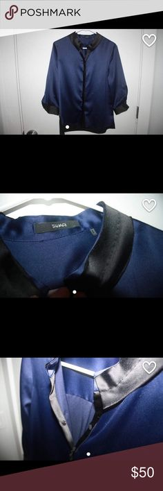 Blue silk blouse button up Navy blue silk blouse with black trim. It's perfect for work or just dressing up. I loved it because the dress is long enough to wear ( it could flow over pants and/or it can be worn tucked in/tied). Elie Tahari Tops Blouses