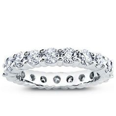 gorgeous 2.14 ct shared-prong diamond eternity band from Adiamor! If only...