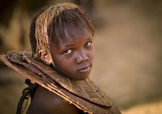 Africa | Pokot girl with traditional necklace.  |  The Pokot people (commonly spelled Pökoot) live in West Pokot County and Baringo County in Kenya and in the Pokot District of the eastern Karamoja region in Uganda. | © Eric Lafforgue