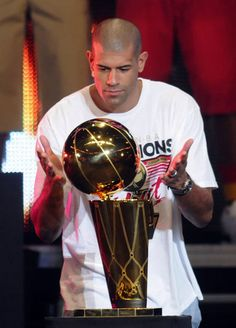Miami Heat Shane Battier admires the Larry O'Brien Trophy during the 2012 Championship Celebration at the American Airlines Arena.