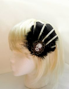 STEAMPUNK feather fascinator  - SKY PIRATE design with skeleton vintage like cameo (Neo Classic) - Choose headband, comb, or hair clip.  via Etsy.