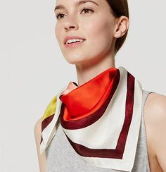 """In luxe silk, this glossy scarf is a decidedly mod-chic outfit transformer. 30"""" x 30""""."""