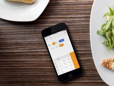 Tydlig being used on iPhone in a restaurant