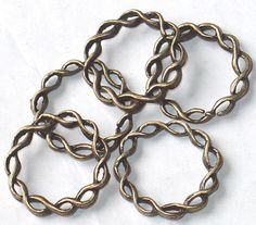 10 pcs of Antiqued brass twisted rings 20 mm by yadanabeads, $2.75