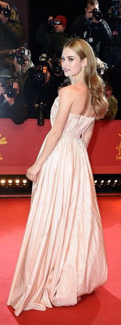 Lily James in a Dior gown at the Cinderella movie premiere.