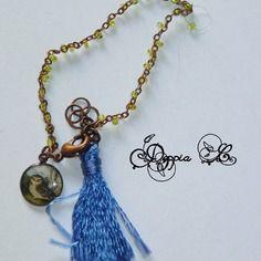 Bracelet à pampille et pompon tons bleu et vert