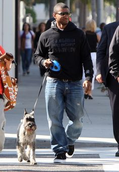 Usher and his Standard Schnauzer Scotty