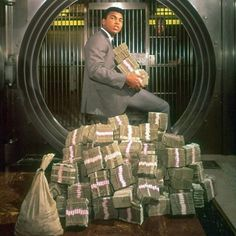 Muhammed Ali sitting on Stacks 🤑 What would you do with all this money?