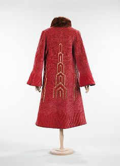 Evening coat (front view) | France, circa 1925 | Materials: silk, fur, metal | This interpretation of a Chinese robe worked in quilting is quite stunning and shows how non-Western design influenced fashion | The Metropolitan Museum of Art, New York