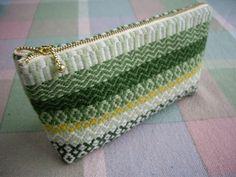 textured stitch needlepoint clutch