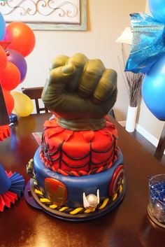 Make this so that the fist is smashing through the cake