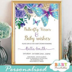 Charming Floral Purple and Turquoise Butterfly baby shower invitations to celebrate the upcoming birth of a new girl with a fun and bright color combination. The Butterfly Baby Shower Invitations feature a beautiful arrangement of hand painted mauve flowers in watercolor with green leaves and fluttering butterflies in purple and turquoise against a white backdrop incorporating faux gold glitter. #butterfly #babyshowerideas #butterflytheme #babyshowerinvitations