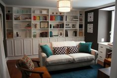 I love a wall of books behind a couch!