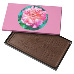 """Framed Pink Rose  Chocolate Box - Box dimensions: 7.75"""" x 13.5"""" x 0.75""""; NET WT 2lbs. 100% Belgian chocolates. Sourced from Belgium with the finest European ingredients. 2lb milk or dark chocolate bar. Cocoa beans sourced from responsibly managed family farms in the Ivory Coast and Ghana. Please note the """"Happy Birthday"""" occasion box comes with 4 convenient pre-made birthday candle holes. Candles not included - $33.95"""