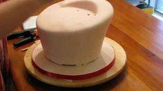 How to Make a Topsy Turvy cake, via YouTube.    http://janellscakes.blogspot.com/2009/02/how-to-make-topsy-turvy-cake.html