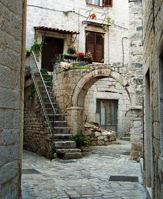 Trogir, Croatia Which to choose? Archway or steps? What would your character do? I just took pictures on those steps this past Tuesday (on Beautiful Castles, Beautiful Places, Places To Travel, Places To See, Trogir Croatia, Old Street, Photos Voyages, Croatia Travel, Montenegro