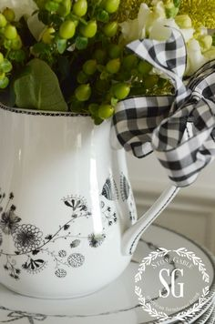 Tie a black and white bow on this pitcher for an extra girly touch.
