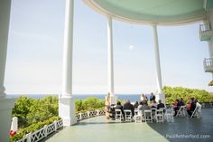 Wedding on Grand Hotel Porch with Minister Tom Marx and flowers by Margaret's Garden.  Photography by Paul Retherford #GrandHotel #MackinacIsland #Minister #Reverend #Mackinaw #Peony #Pink #NorthernMichigan