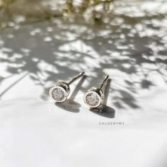 Excited to share this item from my #etsy shop: Dainty Cubic zirconia bezel stud earrings Sterling silver, dot stud earrings, Tragus stud, cartilage stud, tiny 4mm CZ silver earrings Dainty Earrings, Dainty Jewelry, Sterling Silver Earrings Studs, Stud Earrings, Cartilage Stud, Jewelry Polishing Cloth, Druzy Ring, Cufflinks, Perfume