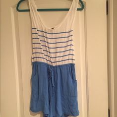 Blue and white stripped short jumpsuit Blue and white stripped short jumpsuit. Silk like material. With drawstring tie at waist. Pockets in front. Pants Jumpsuits & Rompers