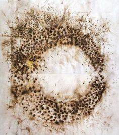 Cai Guo-Qiang, uses gun powder and stencils on room-size canvases laid on the floor then lit on fire. The explosions create beautiful markings. Great video of the process at the link.